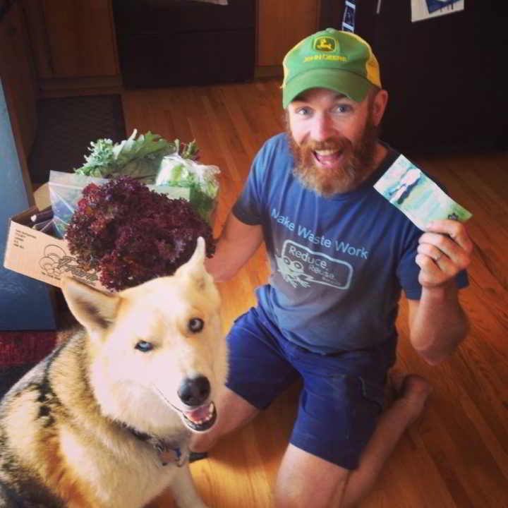 New Farmer Simon Answerth poses with his First CSA Sale at Lightfoot Farm