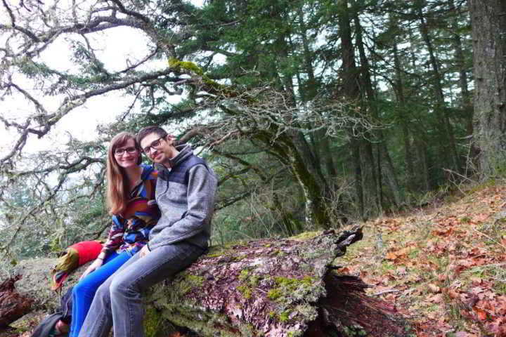 Young Farmers Kailli and Zack take a break from farming on a fallen log