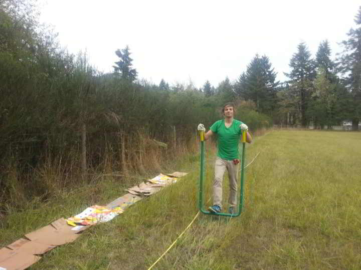Farmer zach broadforking a new field at Dancing Dandelion Farm