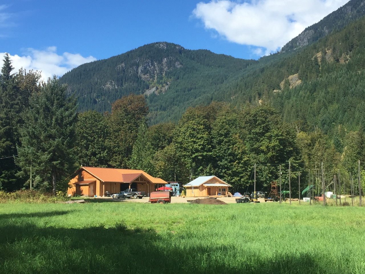 House on Squamish Valley Hop Farm with mountains in the background