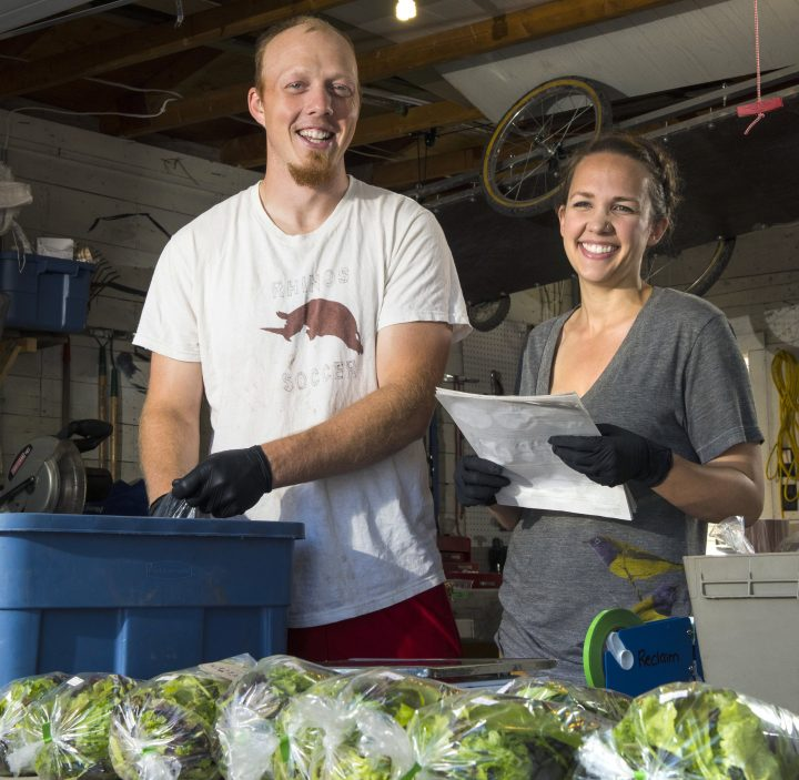 Innovation Award winners Ryan Mason and Cathryn Sprague of Reclaim Urban Farm package green on July 1, 2016. Photo credit - John Ulan