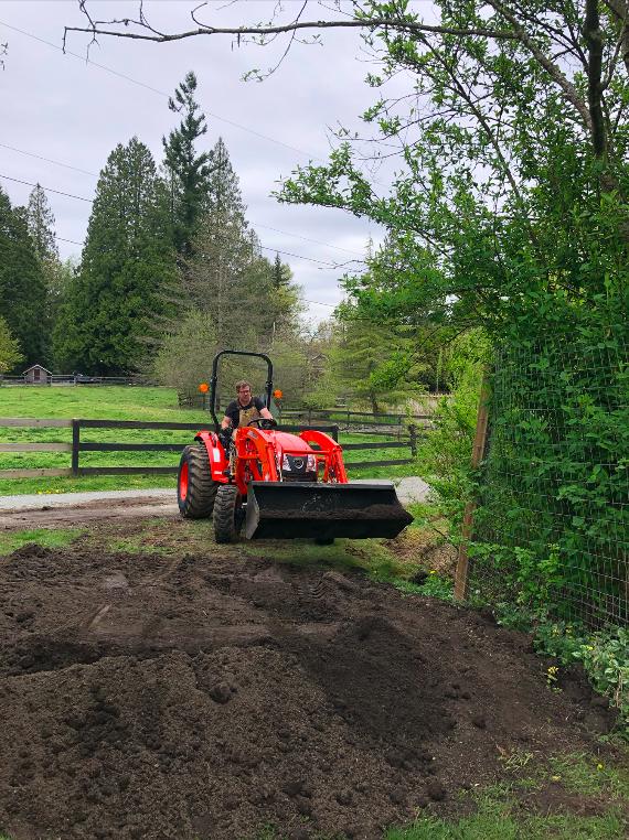 tractor at soil & shovel farm, langley, bc, young agrarians, farm jobs